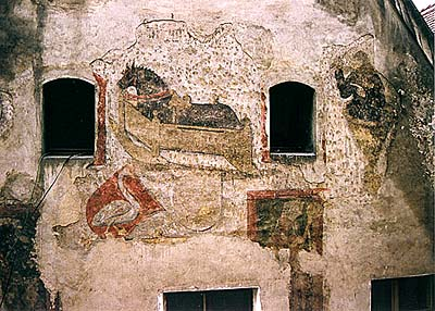Soukenická no. 35, facade, fragments of frescos from 1470's  - St. Florián, horse in cradle, and masked man