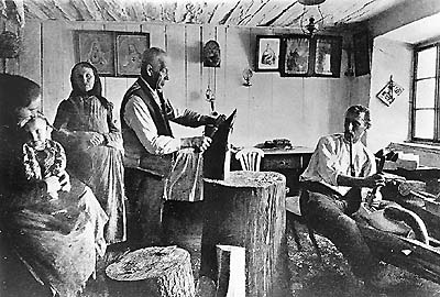 Chopping wood and making sabots, winter work for Šumava residents - historical photo