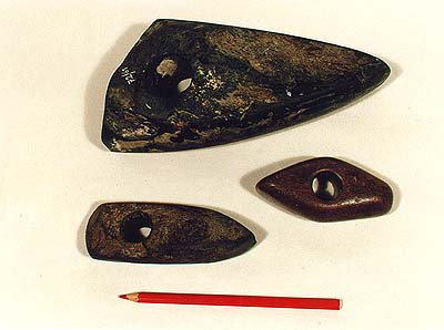 Planished and drilled hammers made of stone discovered in the Český Krumlov region in the early and late Stone Age (approximately 4000 - 2000 BC). The Collection Fund of the Český Krumlov District History and Geography Museum.