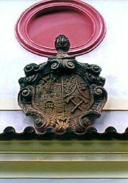 Chapel on Křížová hora (Cross Hill) in Český Krumlov, coat-of-arms of town and miners above the portal