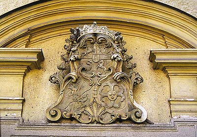 Omlenička, Baroque church from 1732, tympanum of entrance portal with coat-of-arms of the Counts of Nützú and Thürheim, 1st half of 18th century, foto: Lubor Mrázek